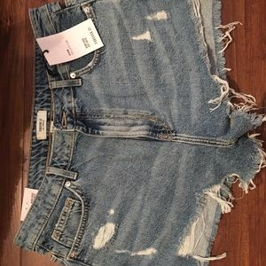 NWT distressed cut offs with cut outs
